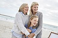 Mother daughter and grandmother spending a day at the beach - SRYF00380