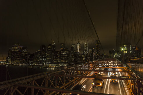 USA, New York City, traffic on bridge at night - UUF10472