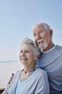 Smiling senior couple on the beach - RORF00760
