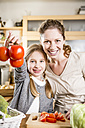 Mother and daughter preparing salad in kitchen - WESTF23013