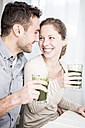 Happy couple drinking smoothie together - WESTF23025