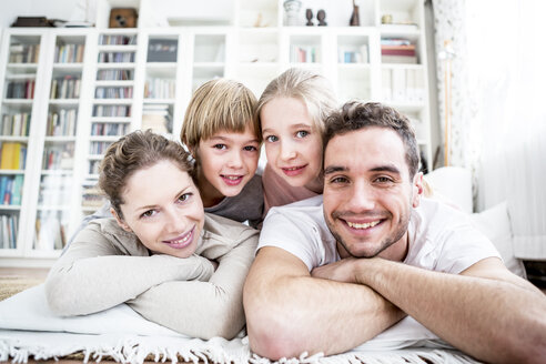 Portrait of happy family at home - WESTF23040