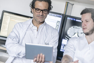 Two doctors holding tablet discussing - MWEF00159