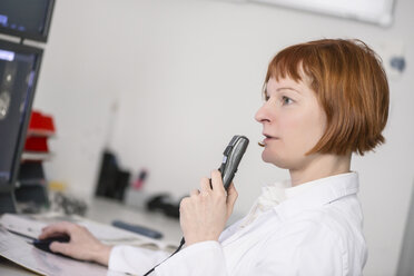 Doctor talking into microphone - MWEF00162