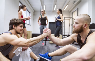 Athletes having a break from exercising in gym - HAPF01639