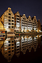 Poland, Gdansk, granaries on Granary Island with reflection on Old Motlawa river by night - ABOF00182