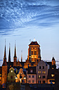 Poland, Gdansk, view to lighted St Mary's church at dusk - ABOF00188