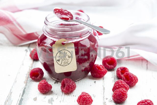 Spoon and jar of raspberry jam and raspberries - LVF06069