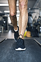 Legs of man on treadmills working out in gym - HAPF01645