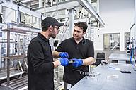 Two men working in factory shop floor - DIGF02357