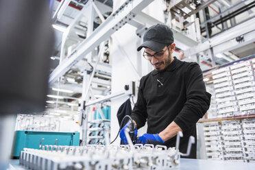 Man working in factory shop floor - DIGF02363