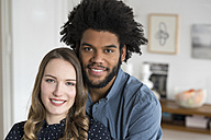 Portrait of smiling couple looking in camera - SBOF00454