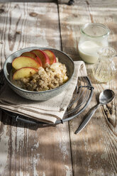 Bowl of porridge with apple and cinnamon - EVGF03215