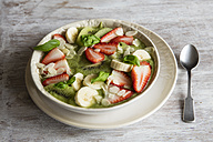 Smoothie Bowl with strawberries, banana, kiwi and slices almonds - EVGF03218
