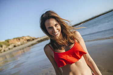 Portrait of happy young woman on the beach - KIJF01461