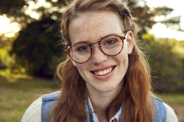 Portrait of redheaded young woman with freckles wearing glasses - SRYF00427