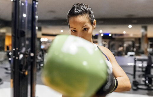 Woman practicing boxing in the gym - MGOF03256