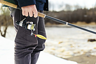 Man fishing in winter - KNTF00838