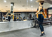 Young woman skipping in the gym - MGOF03296
