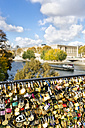 France, Paris, love locks at railing of a bridge over Seine River - MGOF03332