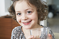 Portrait of smiling little girl with glass - FSF00840