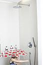 Little girl taking shower with umbrella - FSF00852
