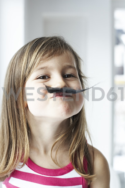 Portrait of smiling little girl with moustache - FSF00855
