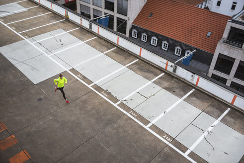 Young man running on parking level - DIGF02399