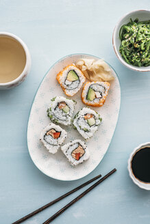 Sushi rolls on a plate, Wakame seaweed salad and green tea - IPF00371