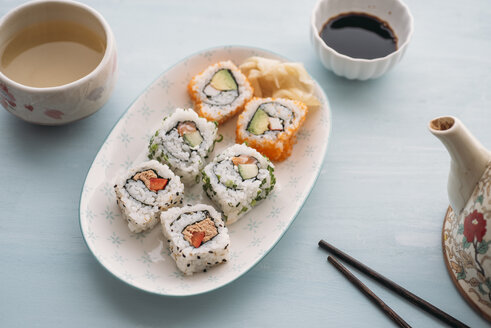 Sushi rolls on a plate with green tea - IPF00374