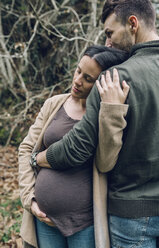 Man with pregnant woman in nature - DAPF00737