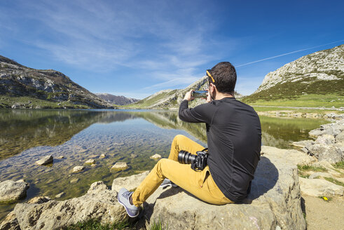 Spain, Asturias, Picos de Europa National Park, man taking picture at Lakes of Covadonga - EPF00439