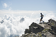 Italy, Alagna, trail runner on the move near Monte Rosa mountain massif - ZOCF00279