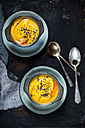 Two bowls of creamed pumpkin soup sprinkled with black cumin - SBDF03205