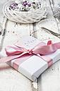 Christmas decoration, scissors and Christmas present on wood - LVF06085