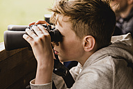 Boy birdwatching with binoculars - NMSF00076