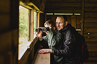 Boy and father birdwatching with binoculars - NMSF00079