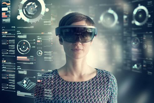 Woman wearing mixed reality smartglasses at transparent screen - RBF05662