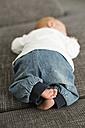 Newborn baby boy lying on couch - OJF00194