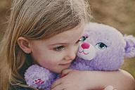Girl cuddling a teddy - NMSF00087