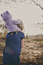 Girl carrying a teddy on her shoulders - NMSF00090