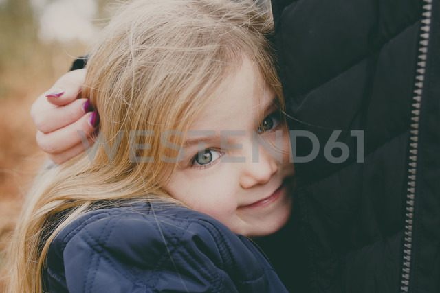 Girl cuddling her mother - NMSF00093