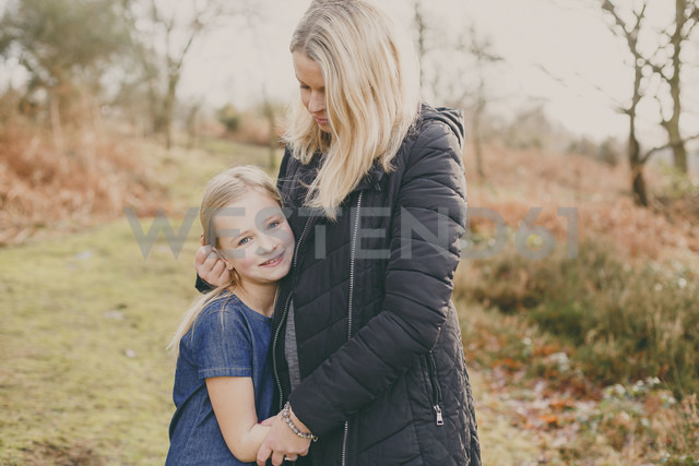 Girl cuddling her mother - NMSF00096