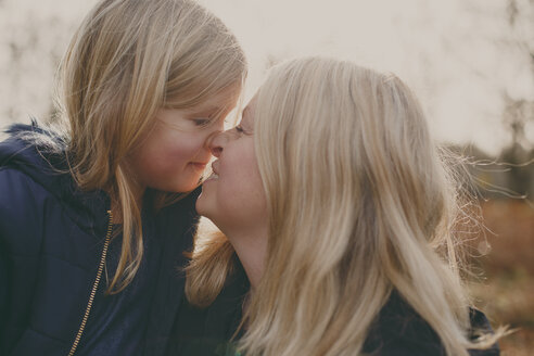 Mother and daughter touching noses - NMSF00105