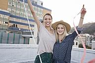 Friends having fun on a rooftop terrace - WESTF23139
