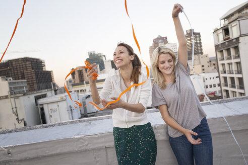 Friends having fun on a rooftop terrace - WESTF23145