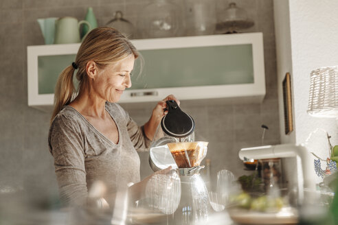 Woman at home in kitchen preparing coffee - JOSF00765