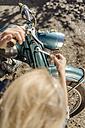 Woman repairing vintage motorcycle - JOSF00777