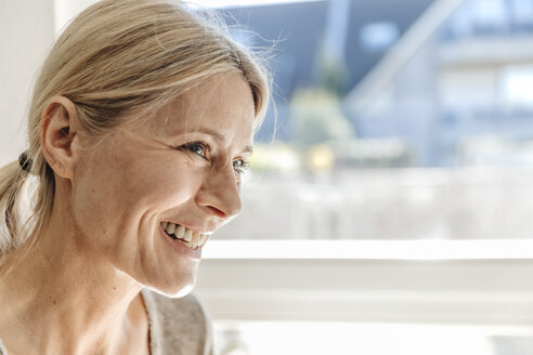 Portrait of smiling woman at home - JOSF00780