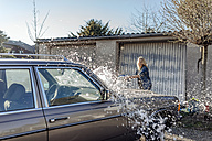 Woman washing her car - JOSF00804